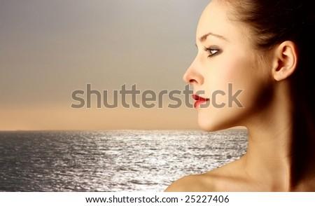 profile of woman at sea - stock photo