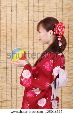 profile of young asian woman in traditional clothes of kimono with paper balloon - stock photo