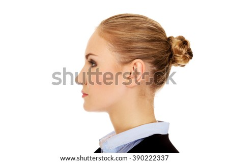 Profile of young blonde business woman - stock photo