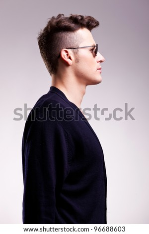 profile picture of a casual young man wearing sunglasses on gray background - stock photo