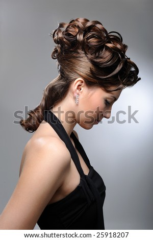 Profile portrait of a female model with beautiful  wedding hairstyle. - stock photo