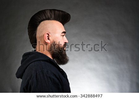 Profile portrait of a mature man with a mohawk - stock photo