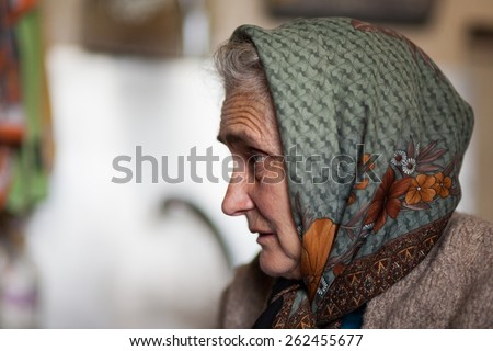 Profile portrait of a rural woman indoor - stock photo