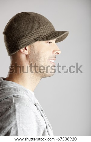 Profile portrait of a young man isolated on a gray background - stock photo