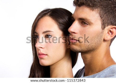 profile portrait of attractive young couple - stock photo