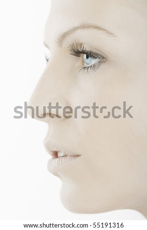 Profile portrait of beautiful blue eyed woman - stock photo