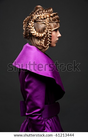 profile portrait of beautiful model with hairdo - stock photo