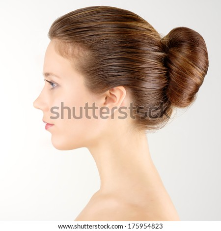 Profile portrait young adult woman with clean fresh skin - stock photo