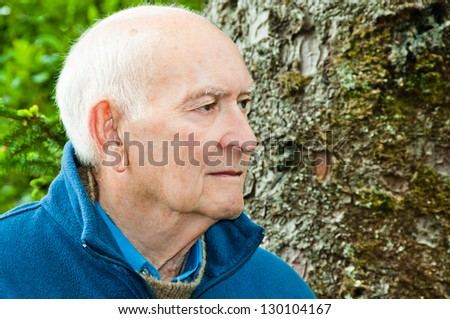 Profile serious mature man - stock photo