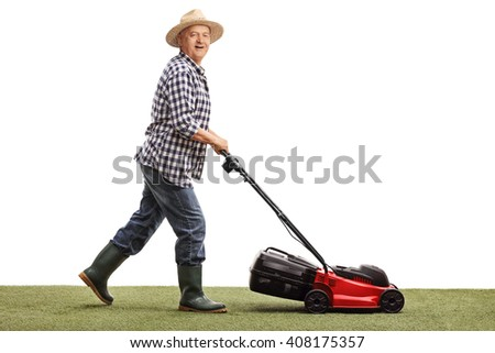 Profile shot of a mature man mowing a lawn with a lawnmower isolated on white background - stock photo
