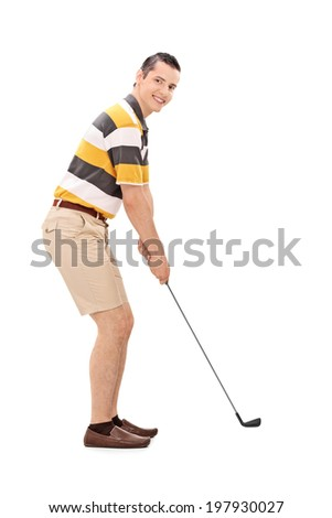 Profile shot of a young man playing golf isolated on white background - stock photo