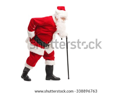Profile shot of Santa Claus walking with a cane and experiencing back pain isolated on white background - stock photo