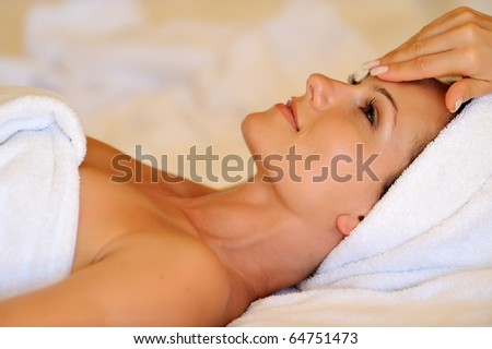 Profile view of a happy young woman preparing for cosmetic treatment - stock photo