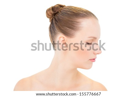 Profile view of a stern pretty blonde model on white background - stock photo