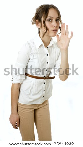 Profile view of a young woman gesturing a verbal call against white background - stock photo