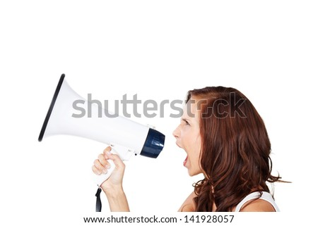 Profile view of an attractive young woman shouting into a loud haler or megaphone making an announcement or to get attention, isolated on white - stock photo