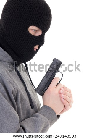 profile view of criminal man in mask holding gun isolated on white background - stock photo