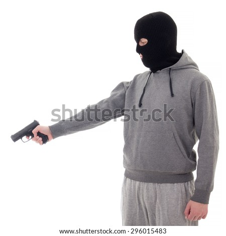 profile view of man in black mask aiming with gun isolated on white background - stock photo