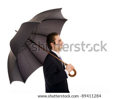 Profile view of young business man with an umbrella against white background - stock photo