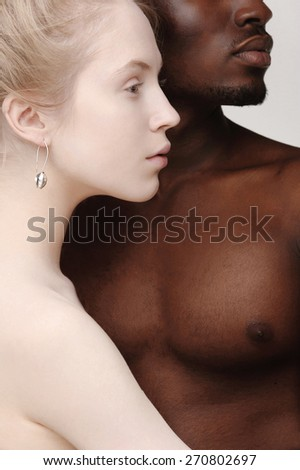 Profiles of young beautiful white girl and a handsome african man - stock photo