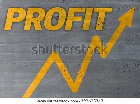 profit graph concept on cement texture background. - stock photo