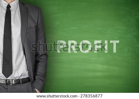 Profit text on green blackboard with businessman - stock photo