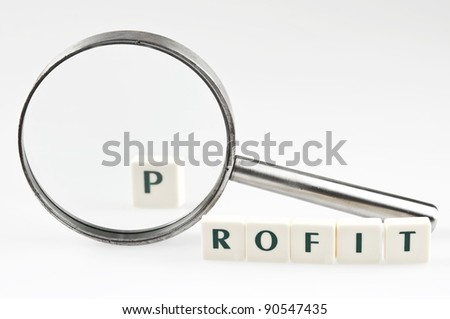 Profit word and magnifying glass - stock photo