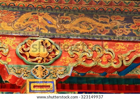 Profusely decorated-carved-painted wooden beams with makaras in the Tashilhunpo-Heap of Glory monastery-seat of Panchen Lama. Shigatse at the Yarlung Tsangpo and Nyang Chu rivers junction-Tibet. - stock photo