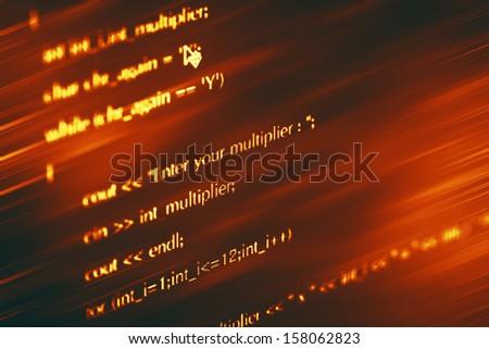 Program code on a monitor - stock photo