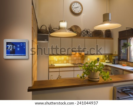 Programmable thermostat for temperature control in kitchen - stock photo