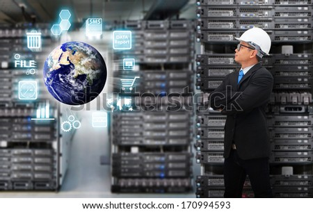 Programmer and digital world with icon control : Elements of this image furnished by NASA - stock photo