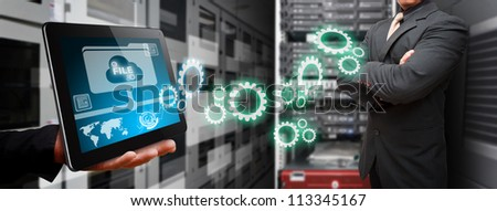 Programmer and gear to create the system in data center room - stock photo