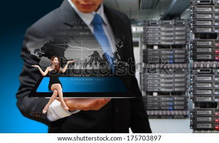 Programmer are working on tablet in server room  - stock photo