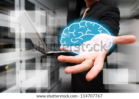 Programmer give the brain in data center room - stock photo