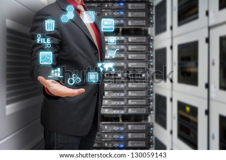 Programmer in data center room and icon control - stock photo