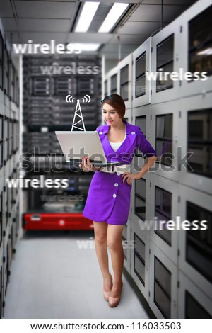 Programmer in data center room  and wireless signal - stock photo
