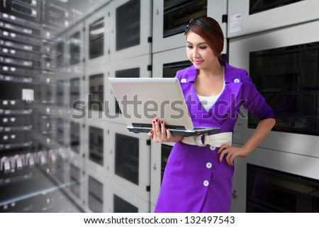 Programmer in data center room for service - stock photo