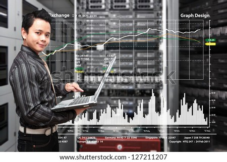 Programmer take control the graph report in data center room - stock photo