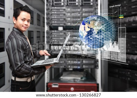 Programmer take control the graph report in data center room : Elements of this image furnished by NASA - stock photo