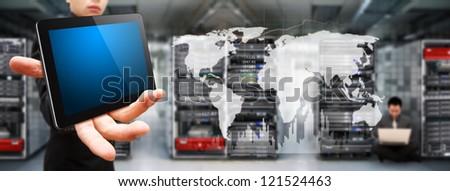 Programmer team in data center room - stock photo