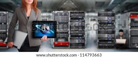 Programmer waiting for service in data center room : Elements of this image furnished by NASA - stock photo