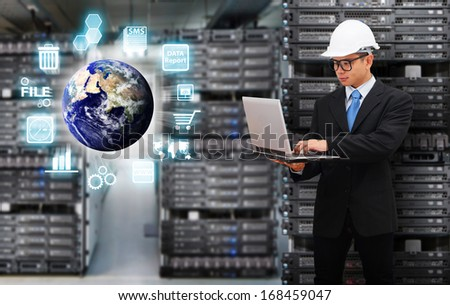 Programmers in data center room : Elements of this image furnished by NASA  - stock photo