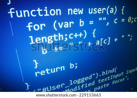 Programming code abstract screen of software developer. Blue computer script. Shallow depth of field and vignette shadow effect. - stock photo