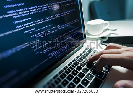 Programming Work Time. Programmer Typing New Lines of HTML Code. Laptop and Hand Closeup. Working Time. Web Design Business Concept. - stock photo