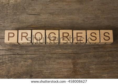 progress text on wooden cubes - stock photo