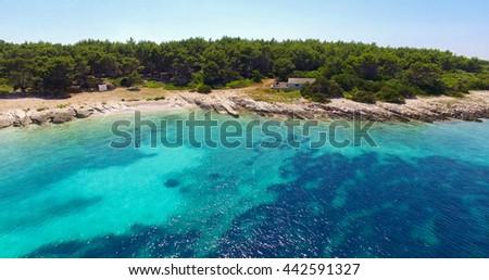 Proizd beach near dalmatian Island of Korcula ,Croatia.Beautiful peaceful island with crystal clear sea full of wildlife.Active summer diving location. Aerial view on beautiful beach.  - stock photo