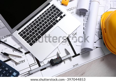 Project drawing and laptop - stock photo