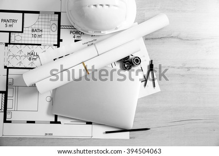 Project drawing and laptop, top view - stock photo