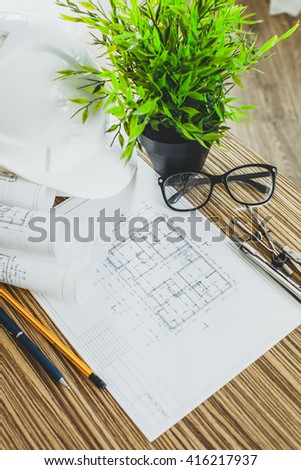 Project drawings and tools, close up - stock photo