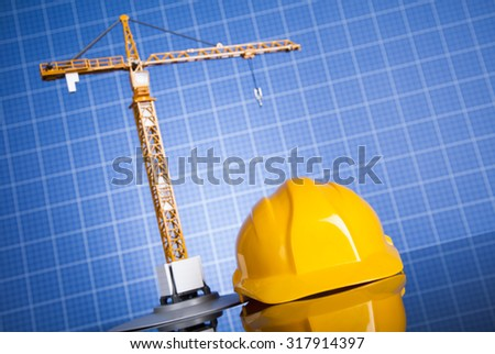Project drawings, building and cranes under construction - stock photo